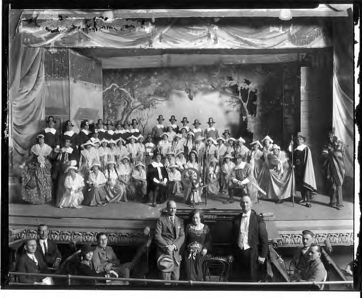 """Community actors on the Centro Asturiano stage for a production of the play """"Priscilla"""""""