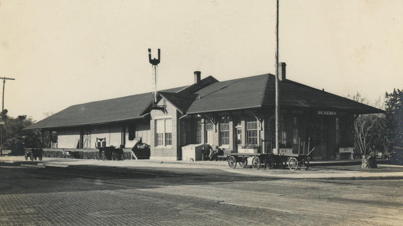 Carts and luggage in front of Dunedin's railroad depot in the 1920's